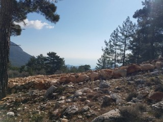 Cheap 1.000m2 Cottage House Land for sale in Kemer Beycik, High Mediterranean Mountain