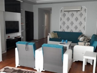 2+1 Apartment For Sale With American Kitchen On The Seafront In Kemer Center