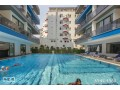 21-apartment-for-sale-with-sea-view-in-mahmutlar-district-of-alanya-small-1
