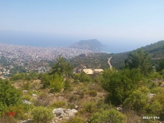 1,500 m2 Land for sale with sea view between Mountains in Alanya