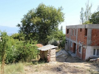 It contains a house and garden. OLIVE FIELD FOR SALE IN KAS VILLAGE
